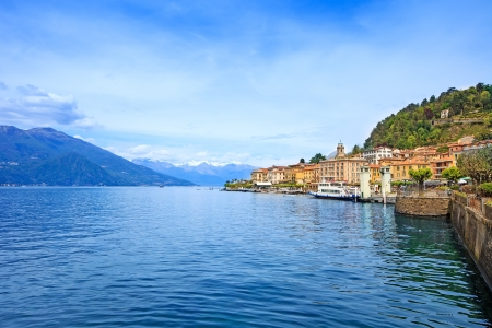 Bellagio town in Como lake district  Landscape with marina and italian traditional lake village  On background Alps mountains covered by snow  Lombardy region, Italy, Europe