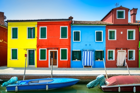 Venice landmark, Burano island canal, colorful houses and boats, Italy  Long exposure photography