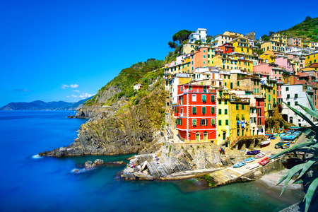 Photo for Riomaggiore village on cliff rocks and sea at sunset , Seascape in Five lands, Cinque Terre National Park, Liguria Italy Europe  Square format  Long Exposure - Royalty Free Image