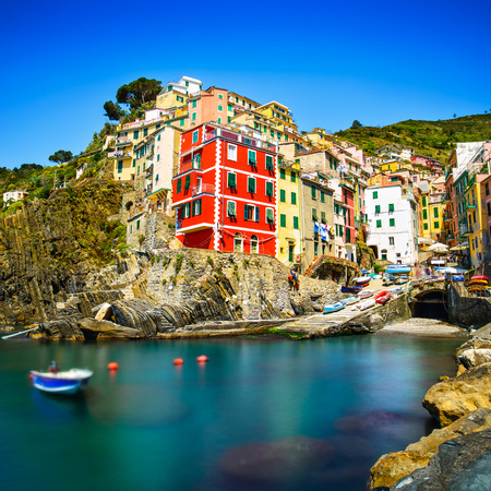 Photo for Riomaggiore village on cliff rocks and sea at sunset , Seascape in Five lands, Cinque Terre National Park, Liguria Italy Europe  Long Exposure - Royalty Free Image