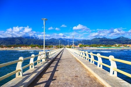Pier footpath promenade, beach and Apuane mountains in Forte dei Marmi Versilia Tuscany Italy