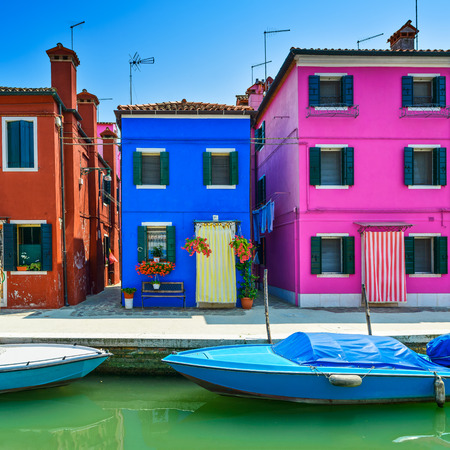 Venice landmark, Burano island canal, colorful houses and boat, Italy, Europe.
