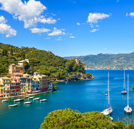 Portofino luxury landmark aerial panoramic view. Village and yacht in little bay harbor. Lig