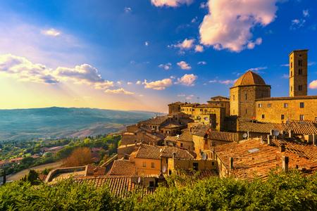 Foto de Tuscany, Volterra town skyline, church and panorama view on sunset. Maremma, Italy, Europe - Imagen libre de derechos