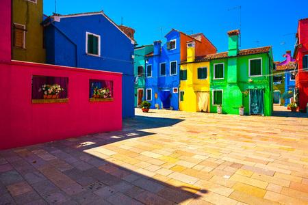 Venice landmark, Burano island square and colorful houses, Italy, Europe.