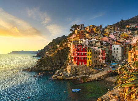 Photo pour Riomaggiore town, cape and sea landscape at sunset. Seascape in Cinque Terre National Park, Liguria Italy Europe. - image libre de droit