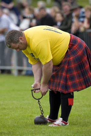 Sportsman about to 'Throw the Hammer' at the Cowal Gathering. A traditional Highland Games held each year in Dunoon in Scotland