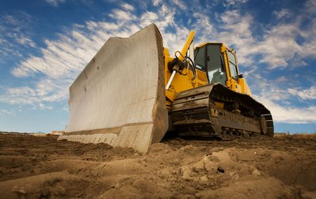Photo for A large yellow bulldozer at a construction site low angle view - Royalty Free Image