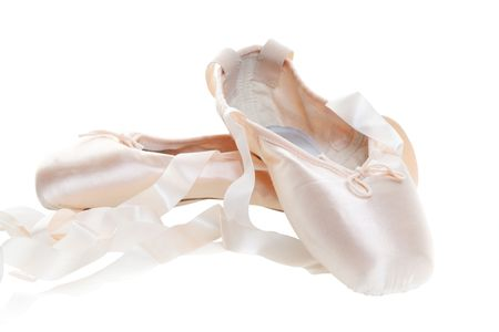 Pink ballet shoes isolated on a white background, Focus on the front shoe.