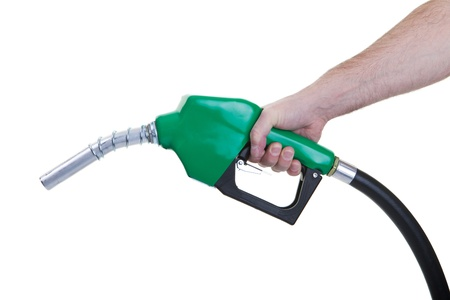 A man holding a green gasoline nozzle on a white background.