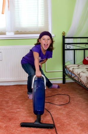 Girl cries when vacuuming her room