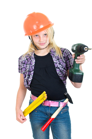 Girl as a craftsman with drill and hard hat