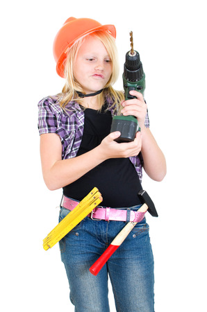 young girl playing with a Battery driller