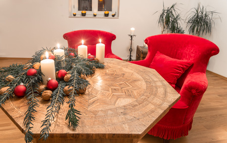 Advent candles with decorated fir tree on a ancient table