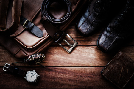 Foto de Men's leather accessories on rustic wooden background, fashion and beauty, travel concept - Imagen libre de derechos