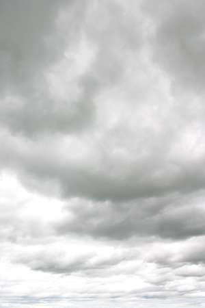 Dark ominous clouds in vertical sky