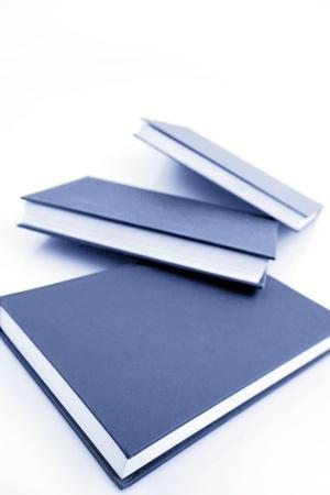 Textbooks on plain background