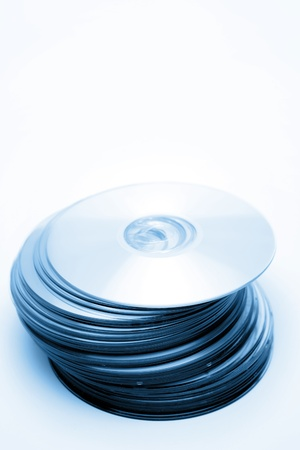 Stack of compact discs on plain background