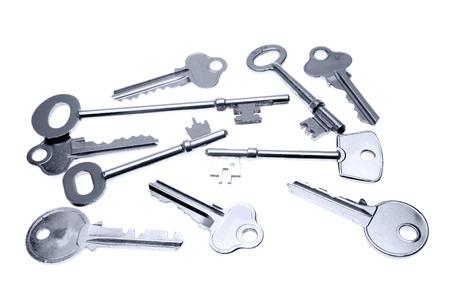 Assorted keys on plain background