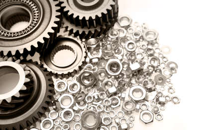 Steel gears and nuts on plain background