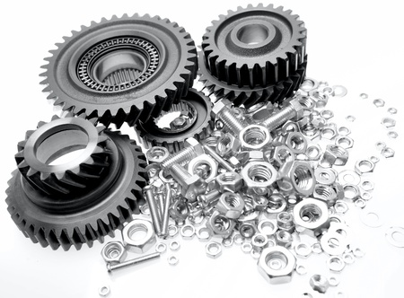 Steel gears, bolts and nuts on plain background