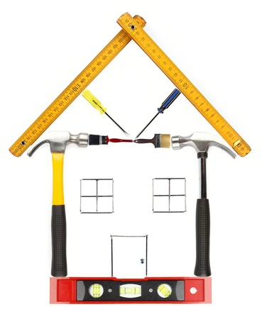 Photo pour House constructed from work tools on plain background - image libre de droit