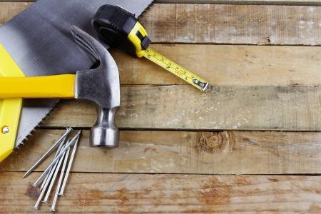 Photo pour Assorted work tools on wooden decking - image libre de droit