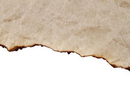 Burnt edge of paper on plain background