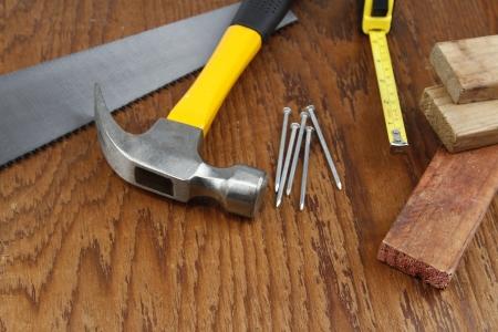 Various work tools closeup on wood