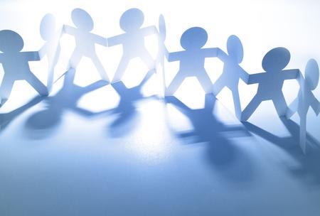 Photo pour Team of paper doll people  - image libre de droit