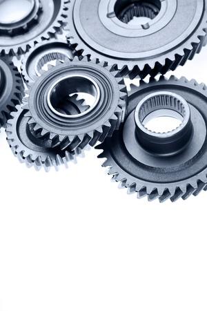 Photo pour Closeup of metal gears on plain background - image libre de droit