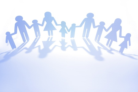Photo pour Paper doll family holding hands. Copy space - image libre de droit
