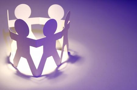 Photo pour Paper chain people holding hands  Teamwork concept - image libre de droit