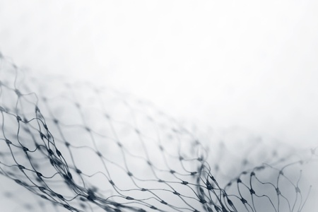 Closeup of abstract fishnet on white background