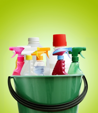 Cleaning bottles in bucket. Green background
