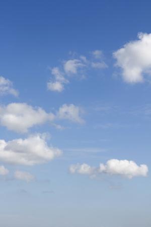 Fluffy clouds in a blue sky