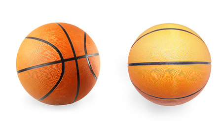 Two basketballs on plain background