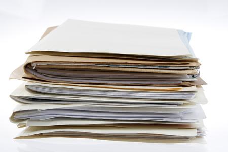 Photo pour Pile of files on plain background - image libre de droit