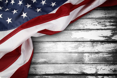 Photo for Closeup of American flag on wooden background - Royalty Free Image