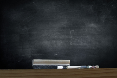 Photo pour Duster and chalk in front of blackboard - image libre de droit