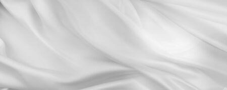 Photo pour Closeup of rippled white silk fabric lines - image libre de droit