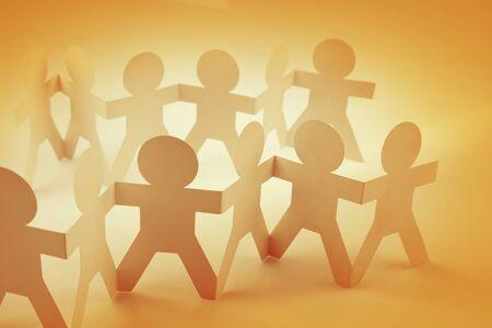 Photo pour Paper chain team holding hands. Teamwork. Partnership - image libre de droit