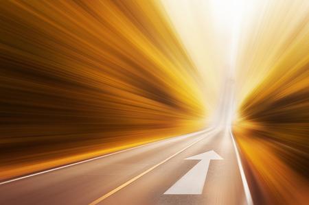 Photo pour Moving arrow on road - image libre de droit