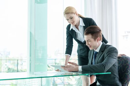Photo for businessman and woman discussing in office - Royalty Free Image