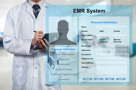 Photo pour Doctor working with EMR - Electronic Medical Record system - image libre de droit