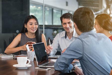 Photo pour 4 people meeting in coffee shop, business casual conceptual - image libre de droit