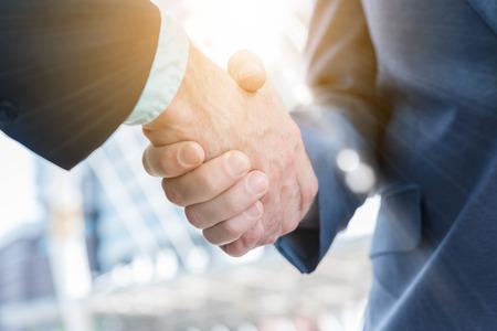 Photo pour Hand shake of two businessman with sun flare, business conceptual - image libre de droit