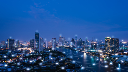Foto de Cityscape with connecting dot technology of smart city conceptual - Imagen libre de derechos