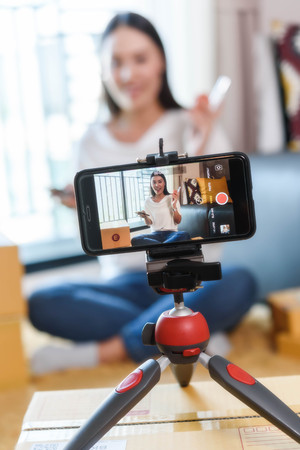 Photo pour Beauty blogger demonstrating how to make up and review products on live broadcast use smartphone, life of an influencer - image libre de droit