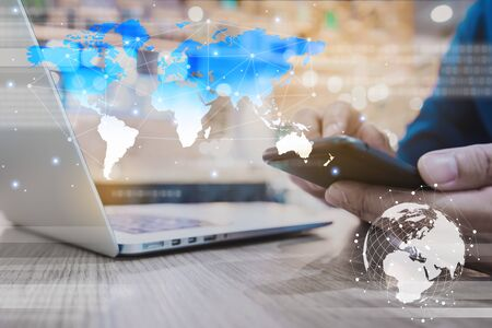 Photo pour Globalization conceptual of technology use laptop and smartphone, wireless internet connection every where - image libre de droit